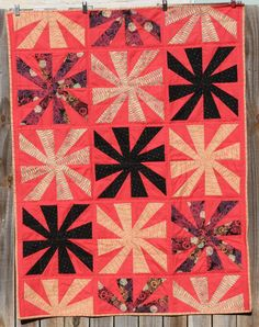 """I'm liking this strange bold salmon color here in this """"Cartwheel"""" baby quilt by Stacy Napier of The Tilted Quilter."""