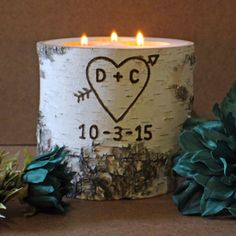 $35 BUY NOW  Play up elements of the natural world at home with this sweet tea light holder, crafted from a birch tree trunk. The maker can customize it with you and your sweetheart's initials, as well as your anniversary date.