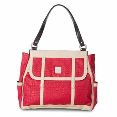 Can a woman ever have enough red? We don't think so! The sizzling Rochelle for Prima Bags adds a punch of color and wow factor to all of your favorite neutral outfits. You'll definitely turn heads each and every time you slip on this überchic Shell. Fire-engine red matte croc faux leather features light tan detailing and rivet accents on the front as well as on the end pockets. Also features snap-closure oversized front pocket.