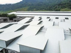 1:1 introduces natural light to a dark production space in the phillipines