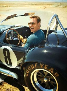 Michael Fassbender in a race car.