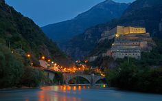 Download wallpapers Valle dAosta, medieval castle, evening, old fortress, old bridge, city lights, mountains, Italy