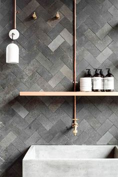 Black tiles bathroom.