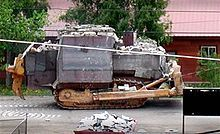Marvin John Heemeyer was a welder and an automobile muffler repair shop owner. Outraged over the outcome of a zoning dispute, he armored a Komatsu D355A bulldozer (known as the killdozer) with layers of steel and concrete and used it on June 4, 2004, to demolish the town hall, the former mayor's house, and other buildings in Granby, Colorado. The rampage ended when the bulldozer got stuck in the basement of a building he had previously destroyed. Heemeyer then killed himself with a handgun.