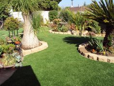 A beautifully landscaped backyard complete with EasyTurf artificial grass. What do you guys think?