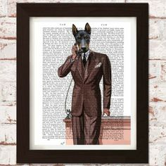Printed onto genuine antique dictionary pages  This Doberman Pinscher on the Phone piece is a print of an original illustration on antique 1800's dictionary pages.