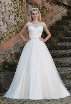 Brides: Sincerity Bridal. The charismatic, princess look created by this ball gown is achieved by an illusion beaded Sabrina neckline, beaded waistband and side draped tulle skirt.