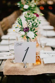 Centerpieces and table numbers. Love the wildflower look. [reception] [flowers]