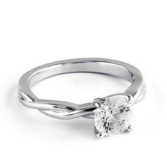 This incredible solitaire design features two delicate strands of high-polish precious metal entwined harmoniously to form an ideal engagement ring. The look provides a perfect showcase for a dazzling center gemstone secured by a classic four-prong setting.
