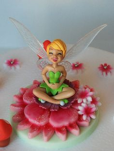So exited I found this Tinkerbell cake topper for only $6 -- my daughter loves to belly laugh so this is so her!!!