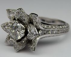 Lotus Diamond ring. I would die. Amazing!
