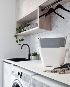 This white sleek countertop is juxtaposed by timber cabinetry and a vintage-inspired goose-neck tap; seeing the old collide with the new. Cabinetry, Room Remodeling, Small Room Bedroom, Laundry Room Design, Laundry Design, Ikea Laundry, Living Room Designs, Laundry In Bathroom, Home Decor