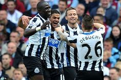 Magnifique: Some of his French compatriots Moussa Sissoko (left), Yohan Cabaye (second left) and Mathieu Debuchy congratulate Ben Arfa, who scored Newcastle's opener and played brilliantly, Sept. 14th. 2013.