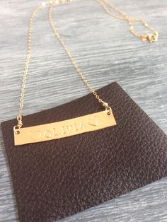 Hand cut and hand stamped on gold filled bar necklace