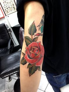 Impressive Red Rose Tattoo On Left Elbow
