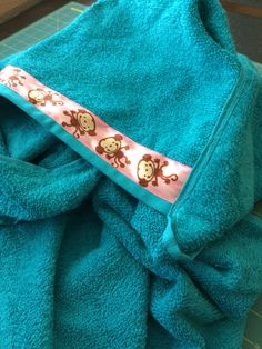 Monkey and teal hooded baby bath towel