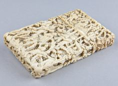 Calling Card Cases — Chinese Carved Ivory Card Case with carved scenes over a pierced background.  C1890.