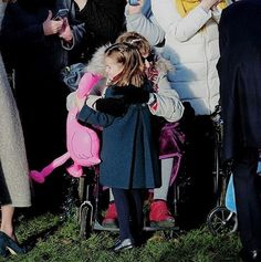 """Lovely Princess Charlotte gives a hug to a well-wisher as she attends Christmas Day Church service at Church of St Mary Magdalene on the…"""" Duchess Kate, Duke And Duchess, Duchess Of Cambridge, Princess Kate, Little Princess, Kate Middleton Family, William Kate, Prince William, Royal Babies"""