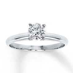 A brilliant round diamond is the main attraction of this diamond solitaire ring. The 3/4 carat diamond is securely prong-set in 14K white gold. Diamond Total Carat Weight may range from .69 - .82 carats.