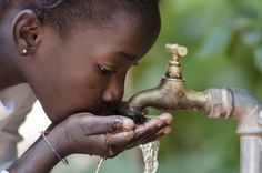 Beautiful African Child Drinking from a Tap (Water Scarcity Symbol). Young African girl drinking clean water from a tap. Water pouring from a tap in the streets of the African city Bamako, Mali. African Children, African Girl, Blockchain, Water Packaging, Water Scarcity, Water And Sanitation, World Water Day, Healthy Water, Places