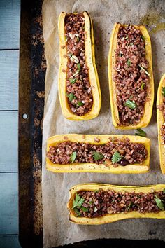 """Delicata Boats with Red Rice Stuffing From """"The Meat Lover's Meatless Celebrations""""  by Kim O'Donnel - get the recipe!"""