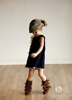 First of all, super cute little girl outfit. Second of all, she has the exact boots I want on... why aren't they in adult sizes??