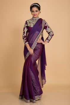 Don this ethereal traditional sari for an elegant ethnic look. The very attractive high neck blouse has been embellished with rich intricate antique zardozi work. The raw silk blouse in combination with the chiffon sari is a great pick for winter festivities. We love the purple hue with antique gold embellishment. It comes with a complementing peticoat.