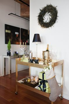 What's a party without a well-stocked (not to mention super stylish) bar? A bar cart is a great way to accessorize a room and create a gorgeous and festive vignette, party or no party. Bar Cart Styling, Bar Cart Decor, Gold Bar Cart, Home Modern, Metal Tree Wall Art, Christmas Themes, Modern Christmas, Christmas Decorations, Holiday Decor