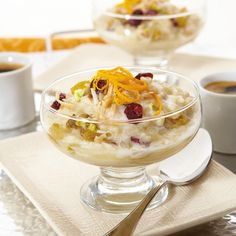 Coconut Rice Custard | Dive into the exotic flavors of coconut, cinnamon and cardamom featured in this creamy, lemony custard. Dotted with golden raisins, sweet-tart cranberries and crunchy pistachios, it's over-the-top good!
