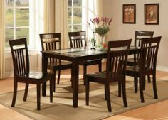 East West Furniture C5G-CAP-W Capri 5PC set with Tempered Frosted Glass Top Table and 4 wood seat chairs by East West Entertainment. $1061.91. Stylish dinette manufactured from quality Asian solid wood.. This Capri table and chairs dinette features a glass top for a refined, modern appearance.. Rectangular dining table with four straight legs for a clean and sophisticated modern design.. Finished in a rich and luxurious cappuccino.. Capri dining sets offer your kit...