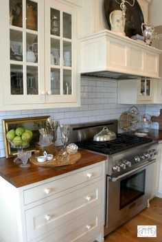 I adore the clean, simple look of subway tile. I picked it for my kitchen back splash. Love it with the gray grout!