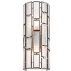 The Hemingway 2 Light Wall Sconce comes in a new bronze finish and has a textured ice shade. The fixture is made of recycled steel material and has the shade of recycled glass.
