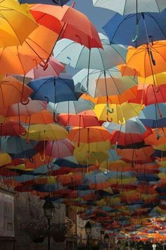 Umbrella Street in Agueda, Portugal Colorful Umbrellas, Umbrellas Parasols, Umbrella Street, Under My Umbrella, Pin Art, Outdoor Events, Beautiful World, Creative Art, Color Patterns