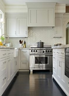 love the subway tile in a herringbone pattern