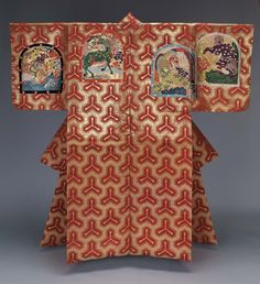 Noh theater robe (atsuita) with an overall design of a tri-pronged tortoiseshell or sword tip motif (bishomon-kikkô) in red silk and gilt paper on the top half of the robe and red and yellow silk discontinuous supplementary patterning wefts on the bottom half.