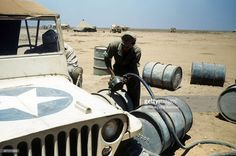 A view as a soldier fills barrels with gas at the U.S Air Force base in Benghazi, Libya.