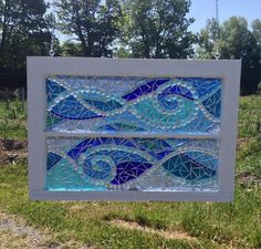 This gorgeous stained glass mosaic features rolling water waves in various shades of blue transparent and translucent glass. All the glass