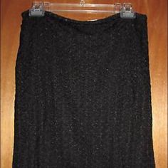 """Jones Wear Black Lace Skirt Sz S Jones Wear black lace lined skirt - size small. 100% nylon.  Zips up the side.  Made in Northern Mariana Islands.  In excellent condition.  Measurements: Waist:  14""""  across the front Hips:  16""""  across the front Total Length:  21"""" Jones Wear Skirts Midi"""
