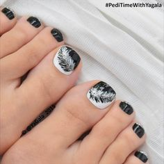Black and white feather toe nail art