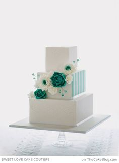 unusual design ~stripes on the side... Square wedding cake