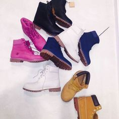 Khloe kardashian's boot collection. Need these pink timberland boots though