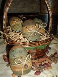 basket of prim eggs, cross stitched pieces would be a nice addition to these