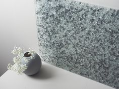 Essis kitchen wall panels, which glitter beautifully in light, are hand-crafted from recycled crushed glass with measurements ordered by the client. Kitchen Wall Panels, Crushed Glass, Recycled Glass, Glass Panels, Recycling, Pearl Earrings, Smooth, Glitter, Face
