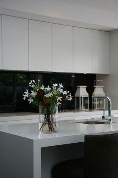Black and white contrast Kitchen splashback. Glass shown by Artform.
