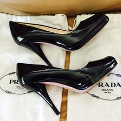 Authentic  Prada Stilettos Classic Black Peep Toe Patent Stilettos!  Perfect addition to your designer collection. Pre-loved with normal signs of wear on bottom of shoes. Comes with dust bags only, no box. Prada Shoes