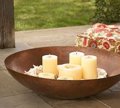 Pottery Barn oversize round candle tray for outdoors. Wine corks for filler Candle Tray, Candle Centerpieces, Candle Holders, Patio Furniture For Sale, Modern Outdoor Furniture, Outdoor Candles, Outdoor Planters, Home Decor Sale, Metal Bowl