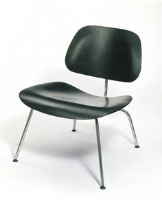 LCM Chair | Designed and manufactured USA, 1947 | Design: Charles and Ray Eames | Materials: moulded plywood, bent tubular steel | The LCM ('Lounge Chair Metal') chair is one of the earliest designs for furniture by Charles and Ray Eames and is one of their purest. This is a lower, lounging version of a taller chair intended for sitting at a table (called the DCM chair, or 'Dining Chair Metal') | VA Museum, London