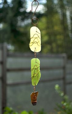 A beautiful glass and copper sun catcher- inspired by nature. The three copper wrapped artist-made beach glass pieces are smooth with a mat finish. This sun catcher measures 18 inches long from the to