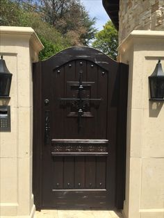 Custom Wood Gate with Decorative Grills, Clavos and Distressing by Garden Passages. Carvings by Others Wooden Garden Gate, Wooden Gates, Wooden Gate Designs, Spanish Garden, Custom Gates, Blue Shutters, Front Gates, Mediterranean Home Decor, Front Entrances