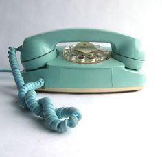 I wonder if this still works? Vintage blue rotary phone.